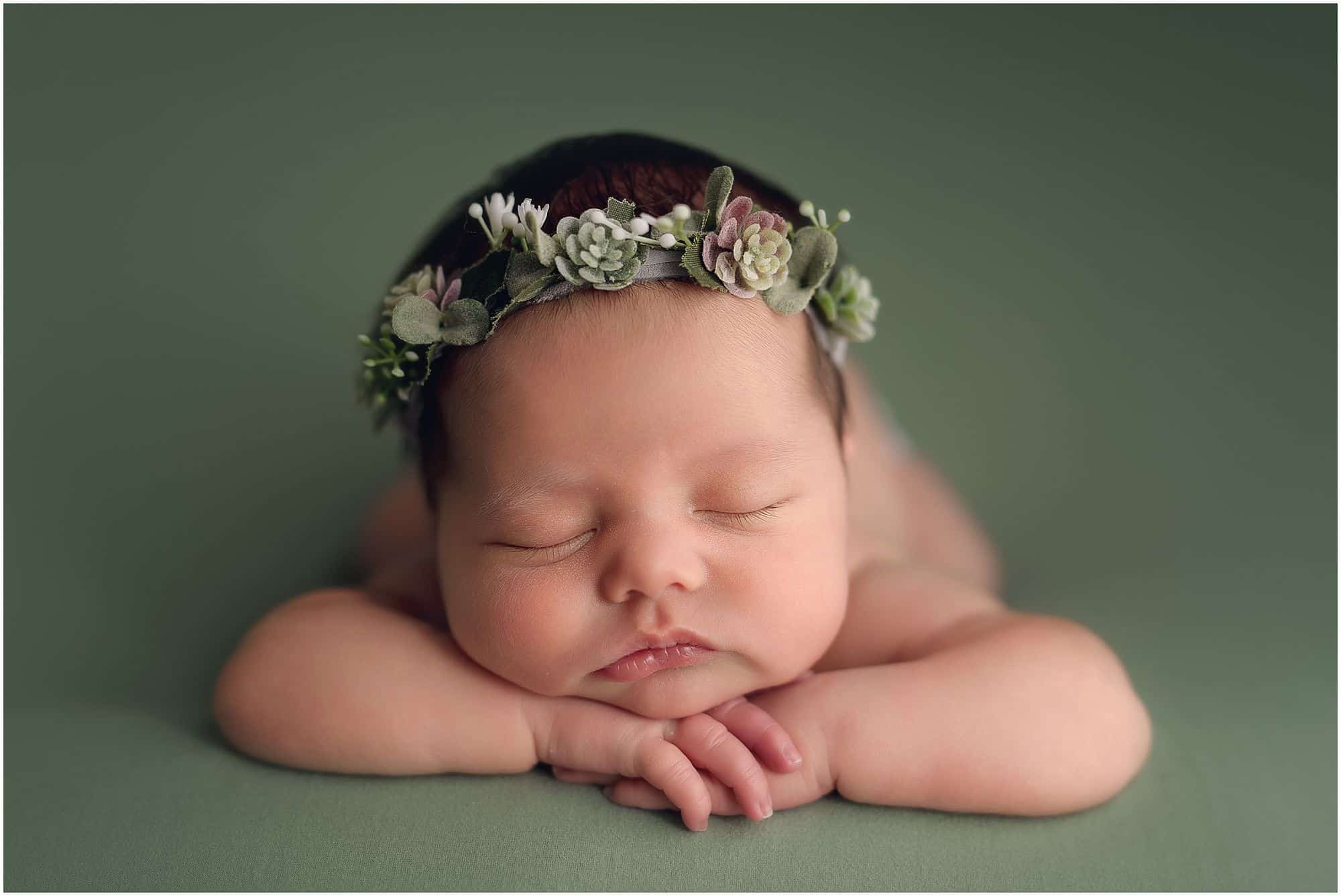 cincinnati newborn photographer Samantha sinchek captures beautiful sleeping baby girl on green