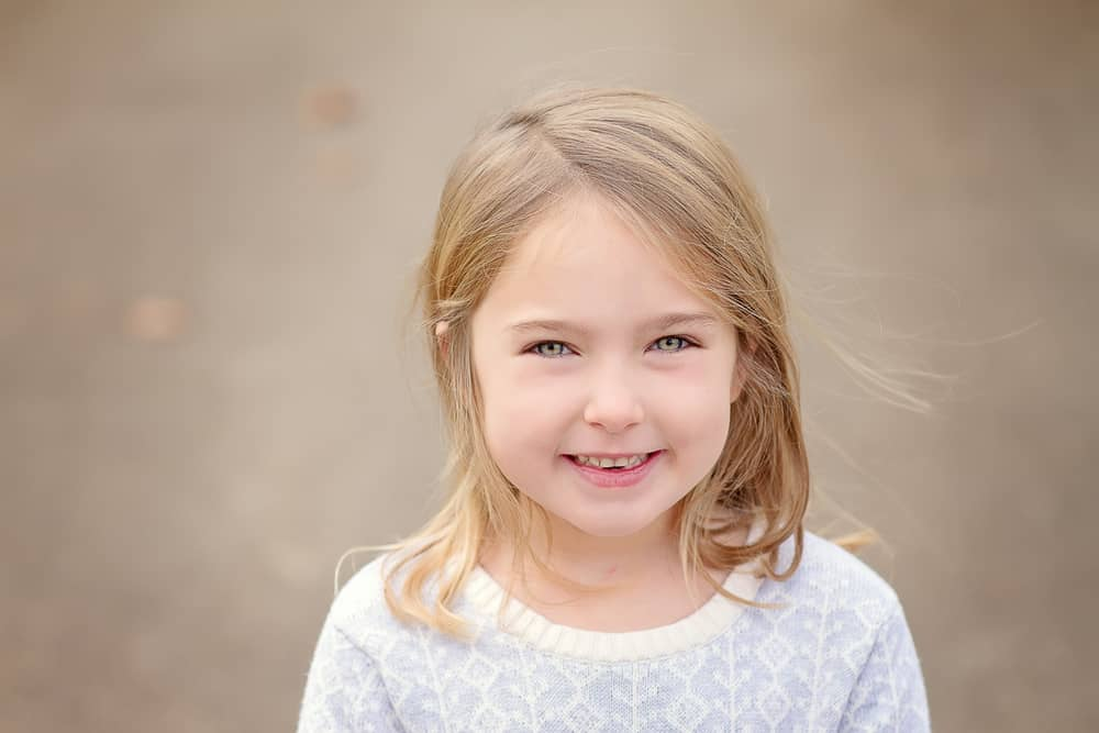 beautiful girl smiles at the camera during her Cincinnati photo session