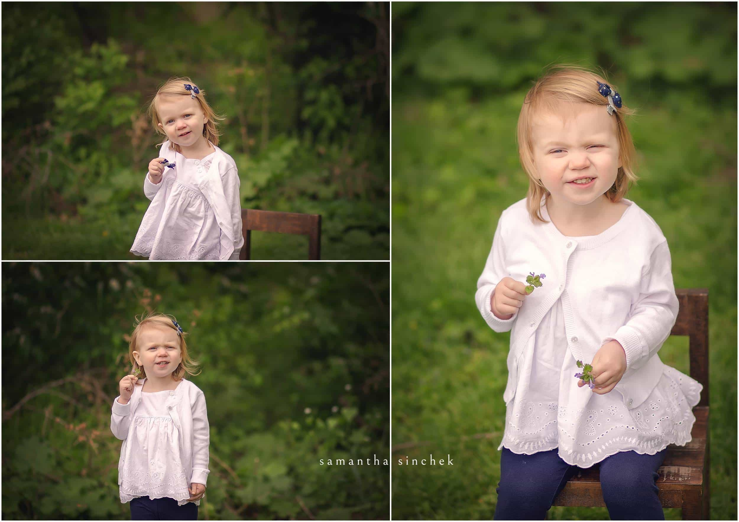 YOUNG DAUGHTER HOLDS A FLOWER AT CINCINNATI FAMILY SESSION