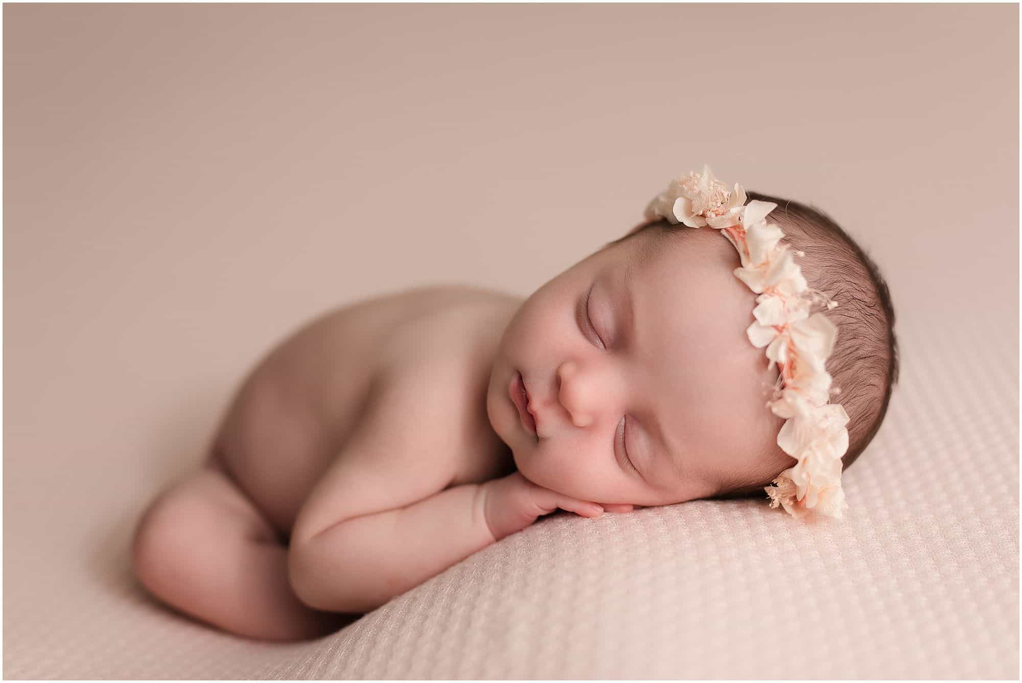 newborn girl sleeps on pink background at pictures with Samantha sinchek photography in cincinnati ohio