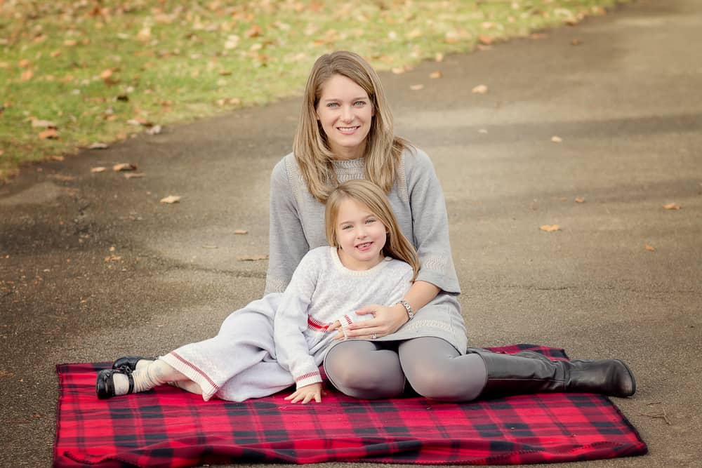 mother and daughter pose on a blanket during their family pictures with Samantha Sinchek Photography