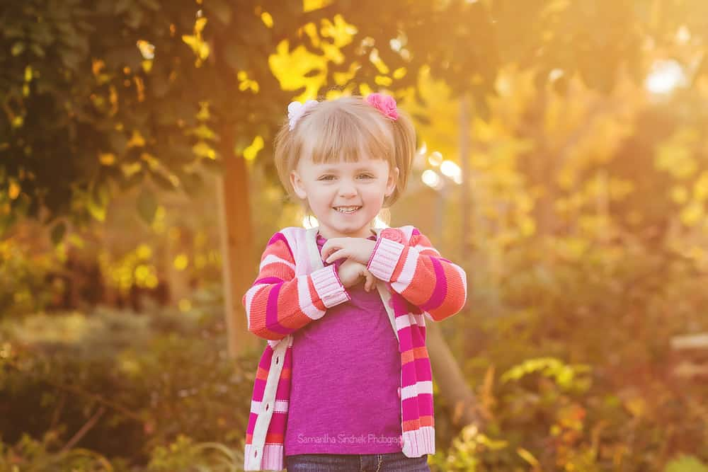 Backlit photo of a toddler girl at a family photo session with Samantha Sinchek Photography