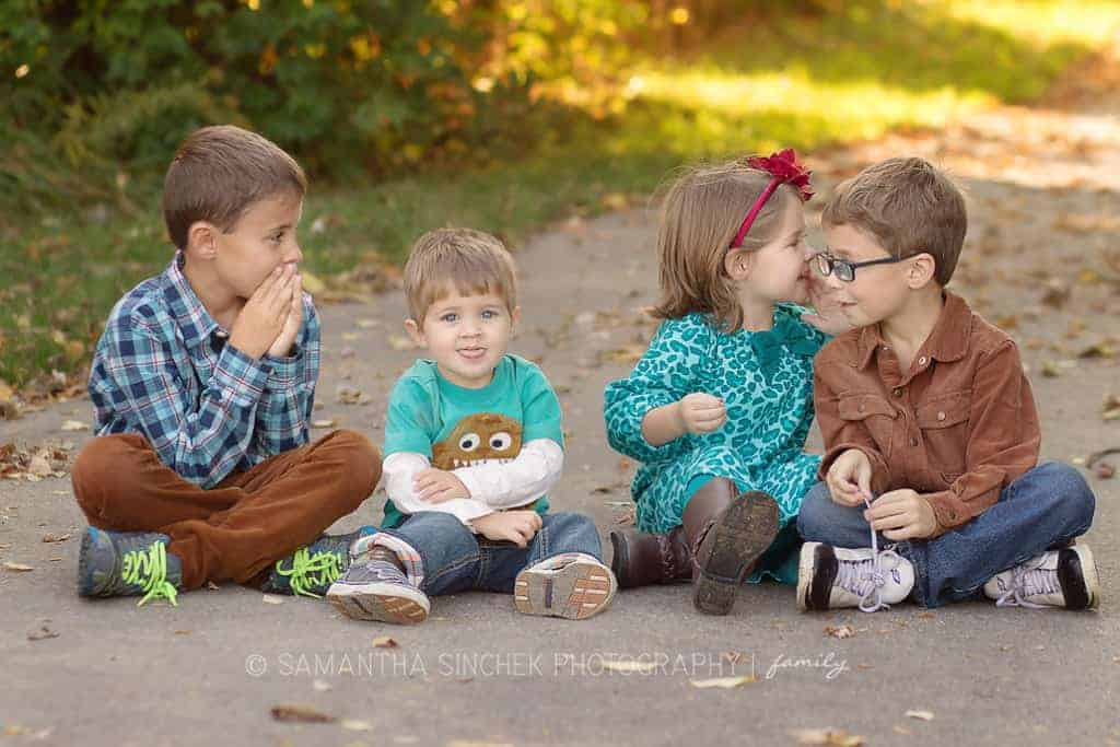 4 siblings whisper to each other