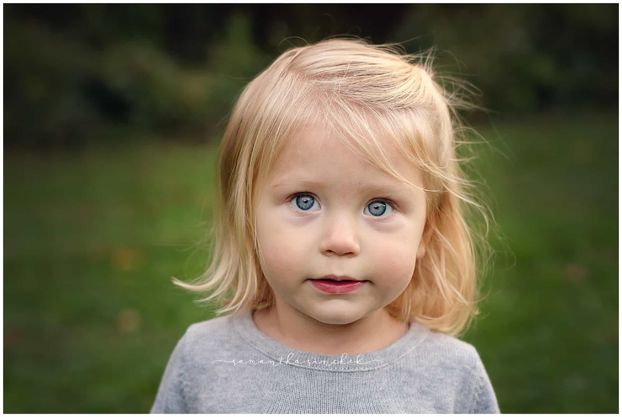 blue eyed child during photo session with samantha sinchek photography