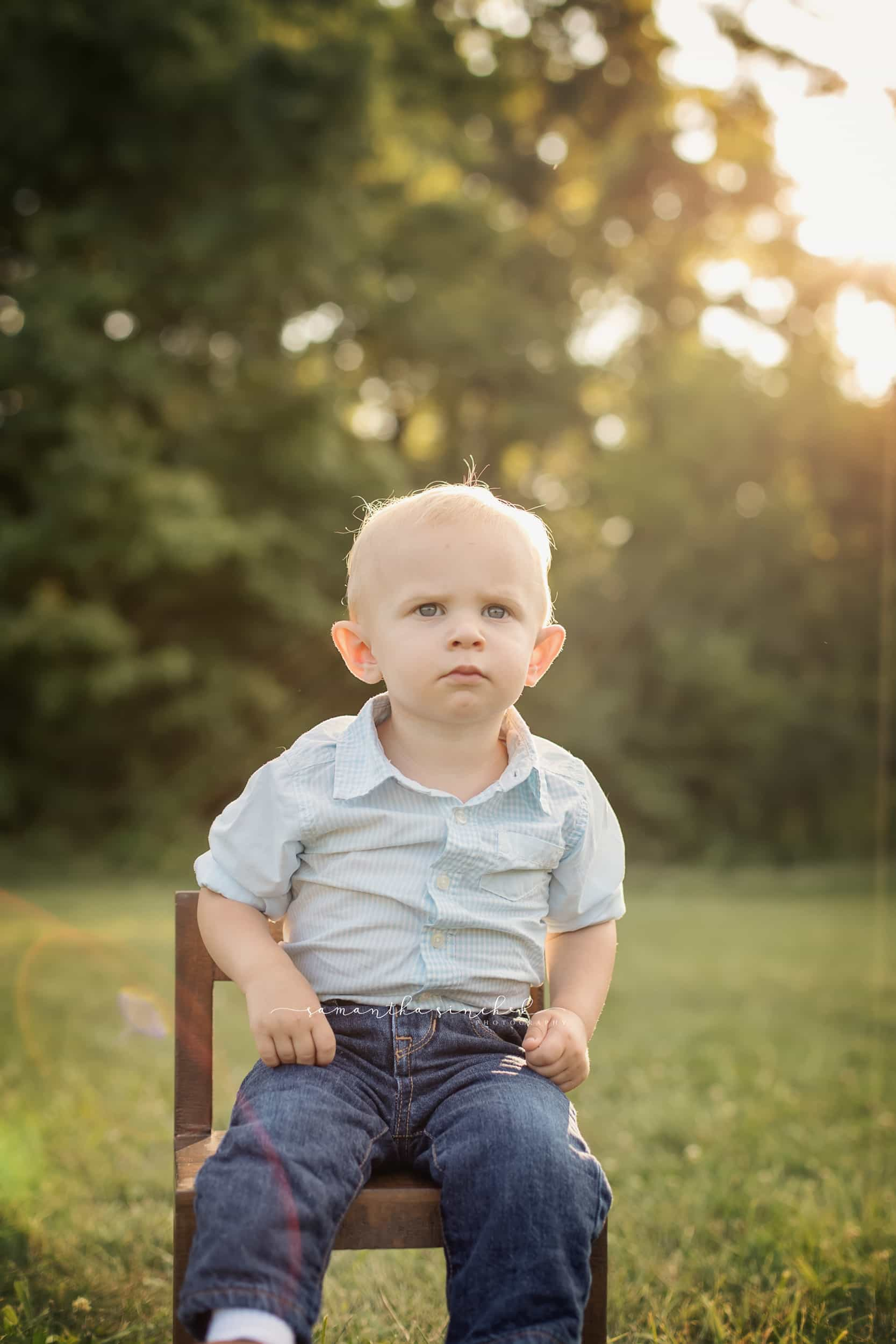 young boy sits at cincinnati family photography session with samantha sinchek