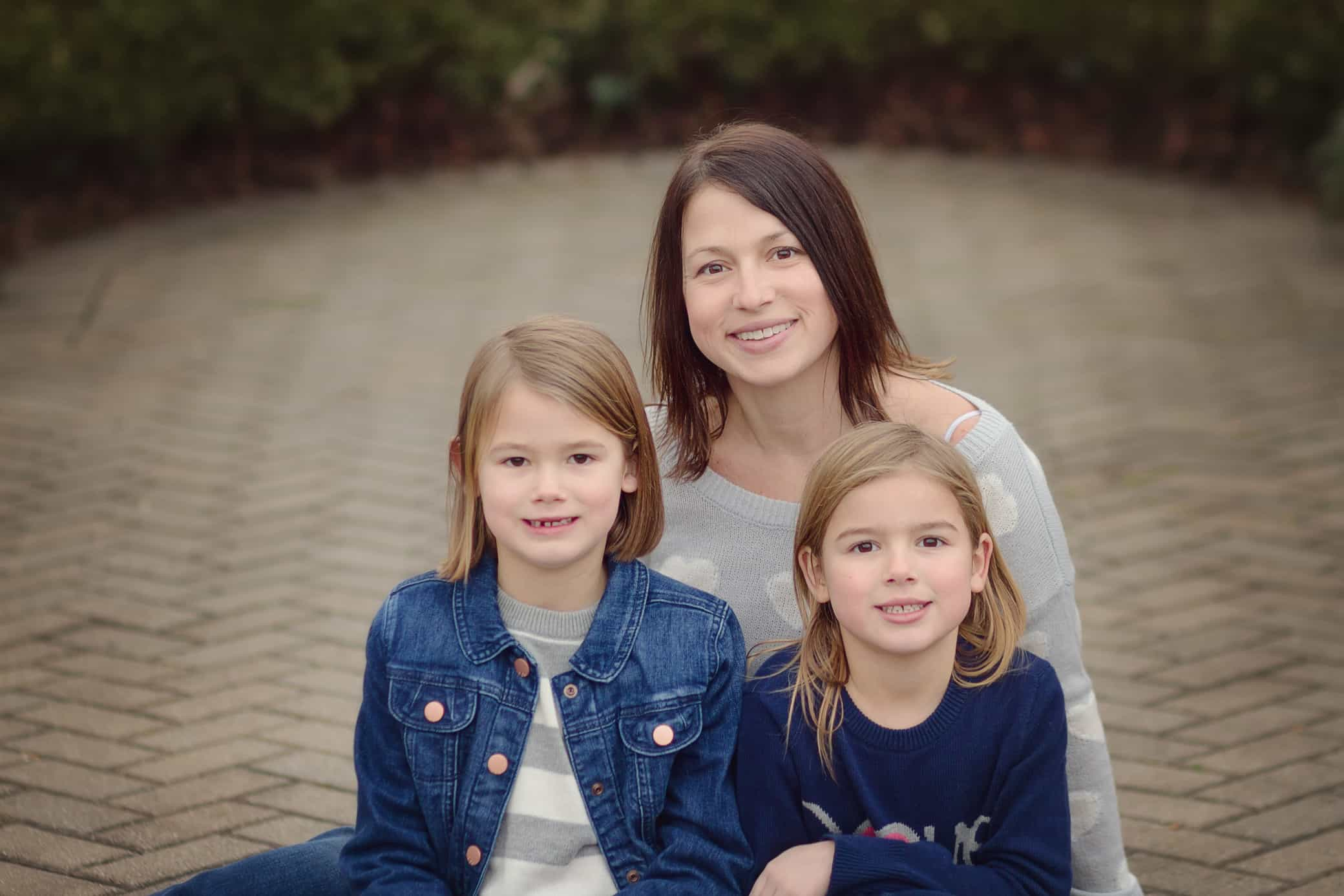 Mother sits with two daughters at Ault park