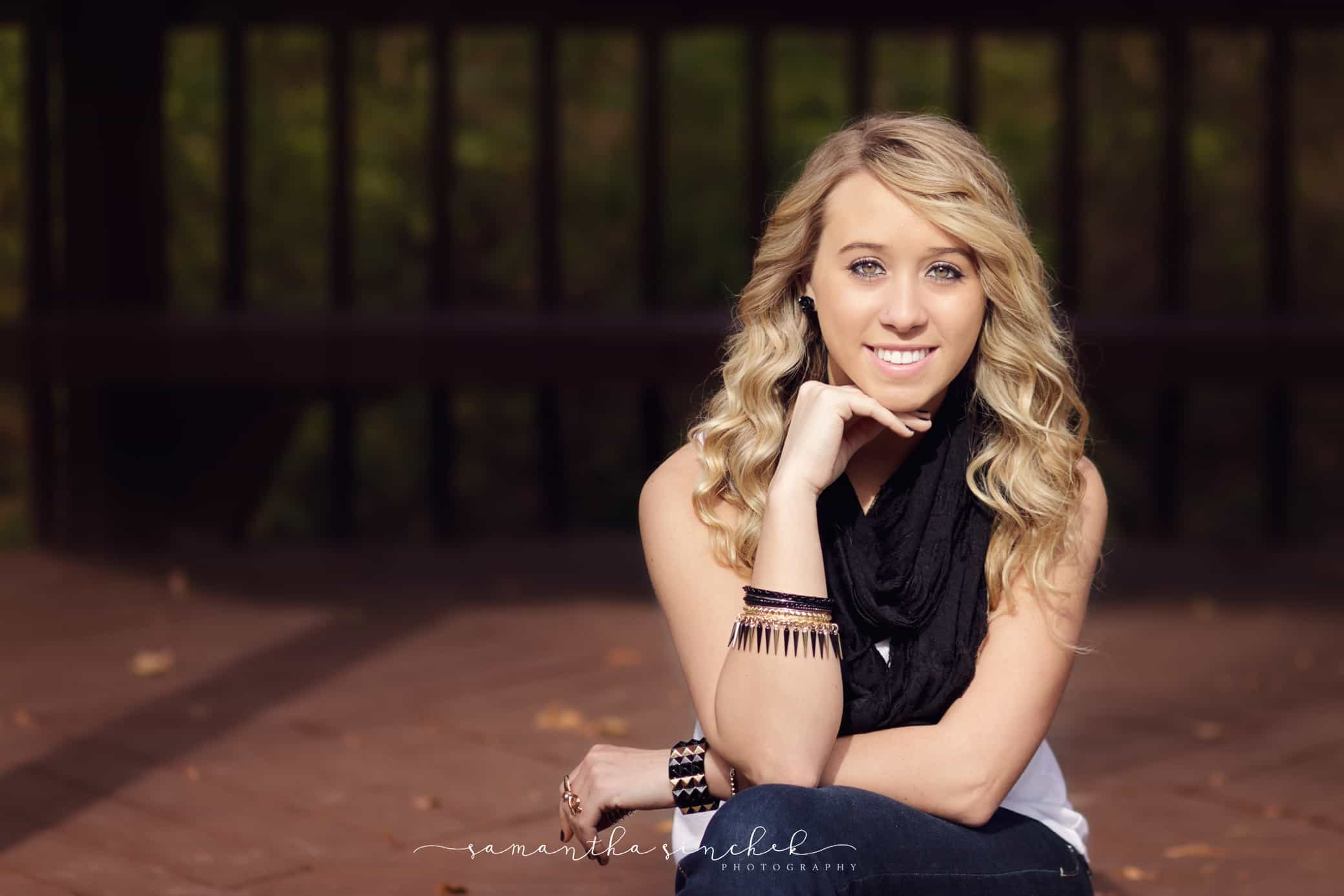 high school senior wearing scarf at photo session in blue ash ohio