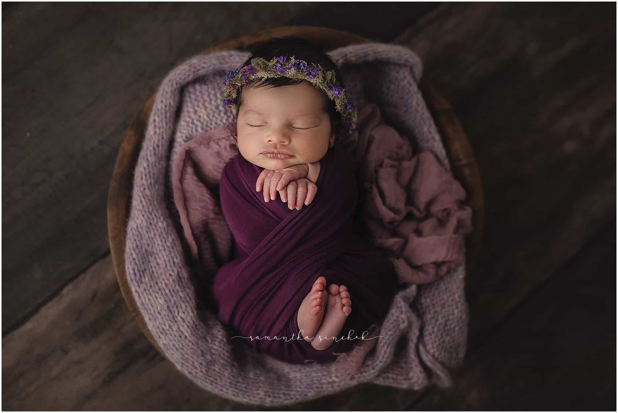 newborn girl sleeps on beautiful purple background with Samantha Sinchek photography of Cincinnati Ohio