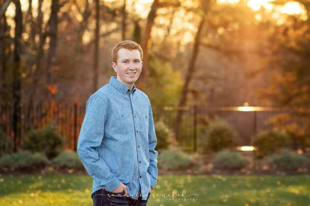 high school senior teen stands at ault park