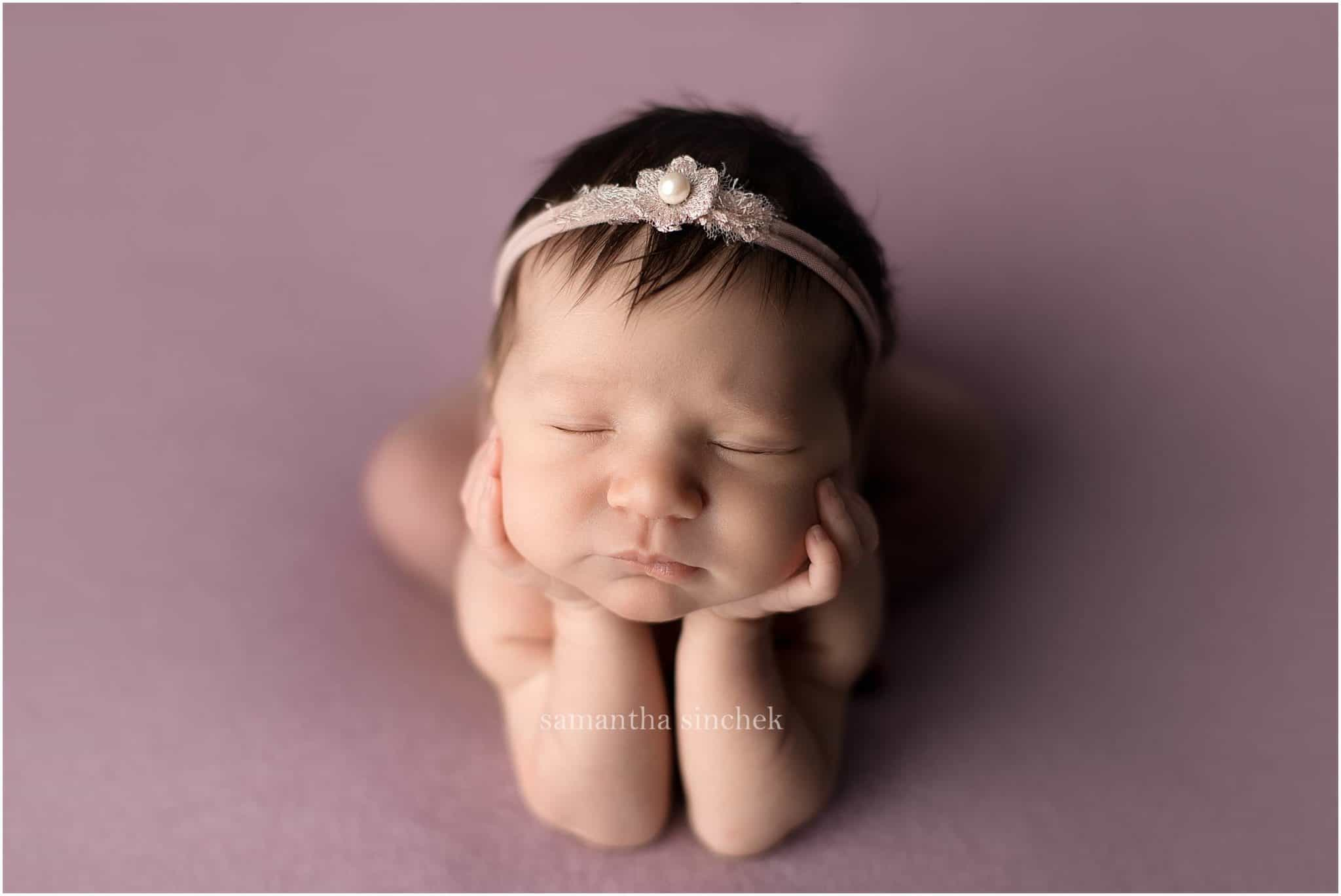 baby girl asleep on purple background with cincinnati newborn photographer Samantha Sinchek