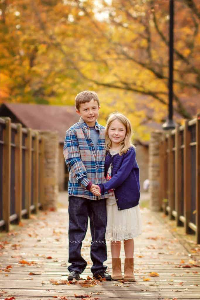 brother and sister smile at camera during photo session with samantha sinchek photography