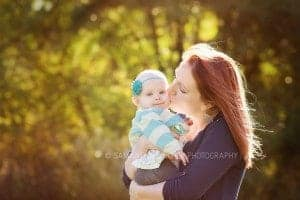 ,other kisses toddler girl on head at family session with samantha sinchek