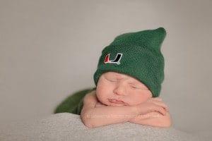 cincinnati newborn wears miami hurricanes beanie