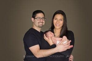 mother and father hold newborn son