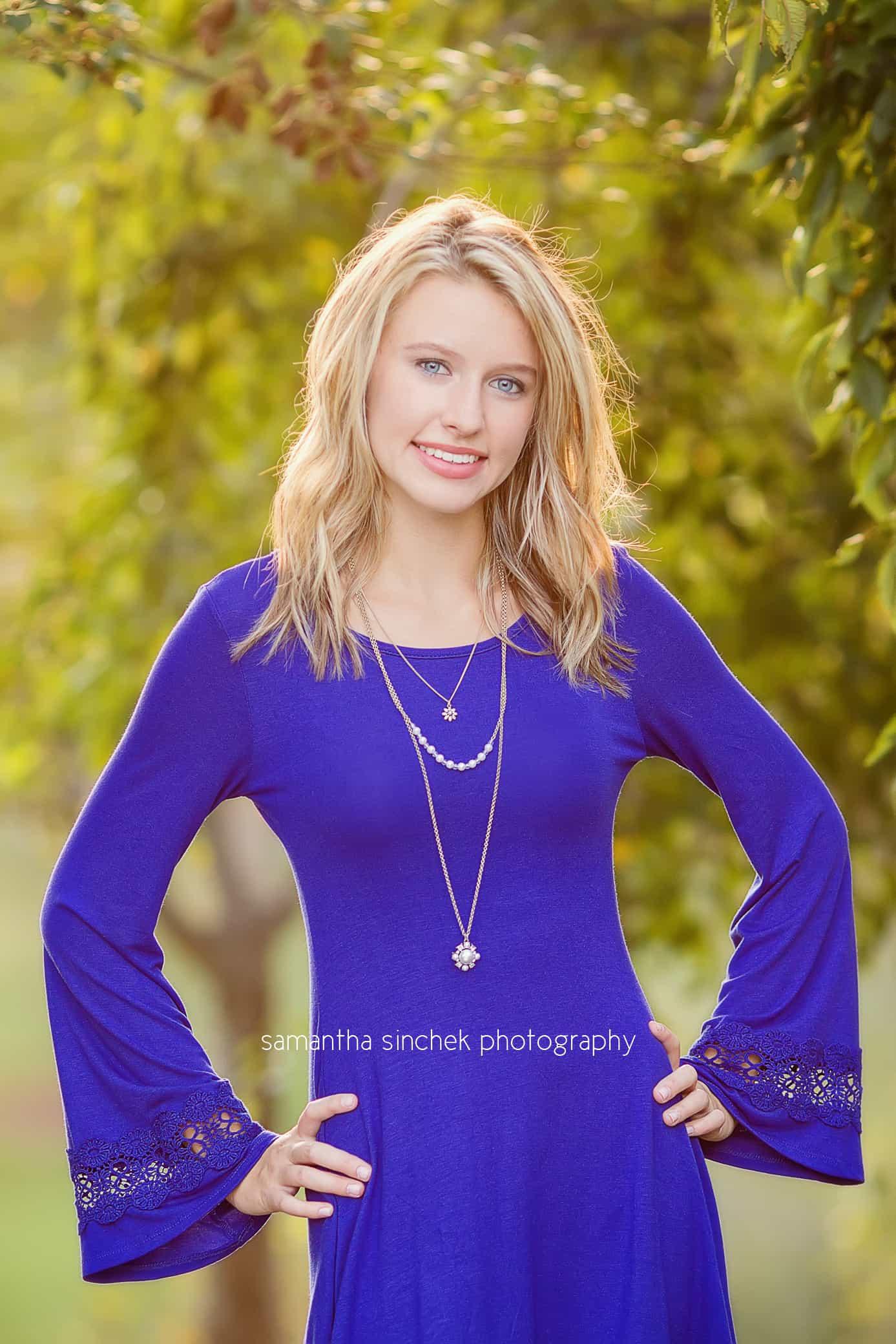 senior girl wears blue dress
