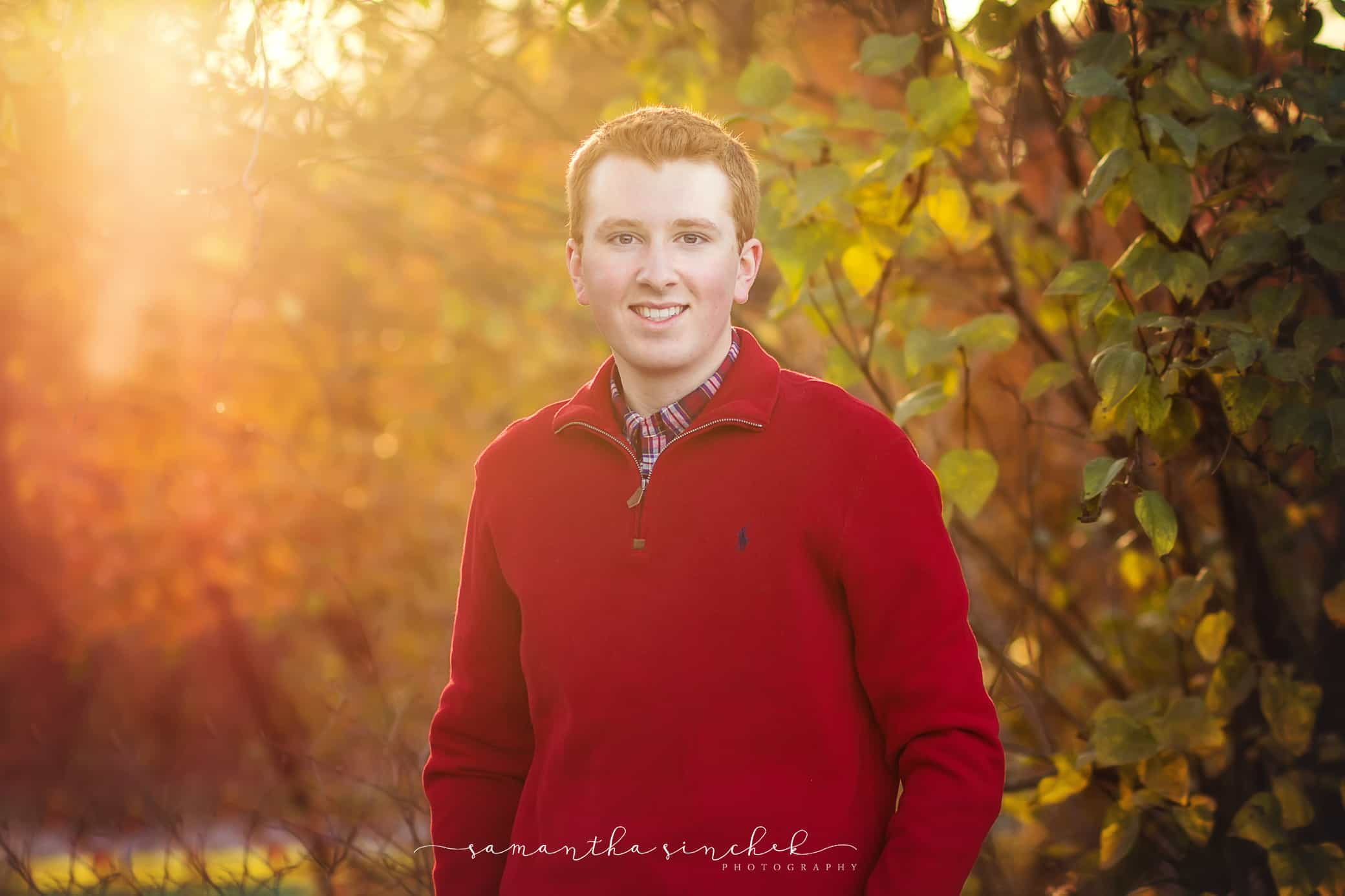 cincinnati senior boy stands bathed in warm sunlight