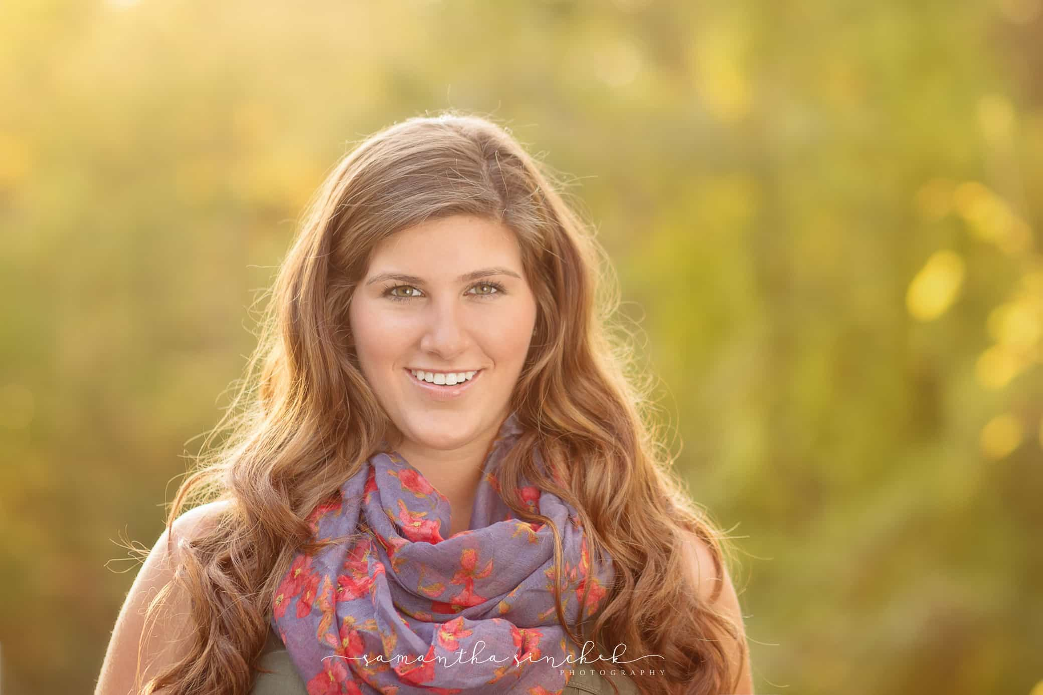 beautiful high school senior bathed in warm fall sunlight at sharon woods