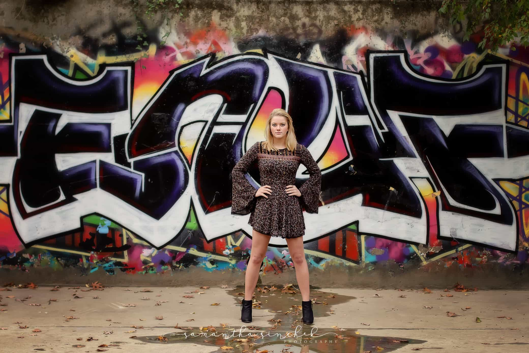 Mason Ohio senior stands with hands on hips in front of cool graffiti