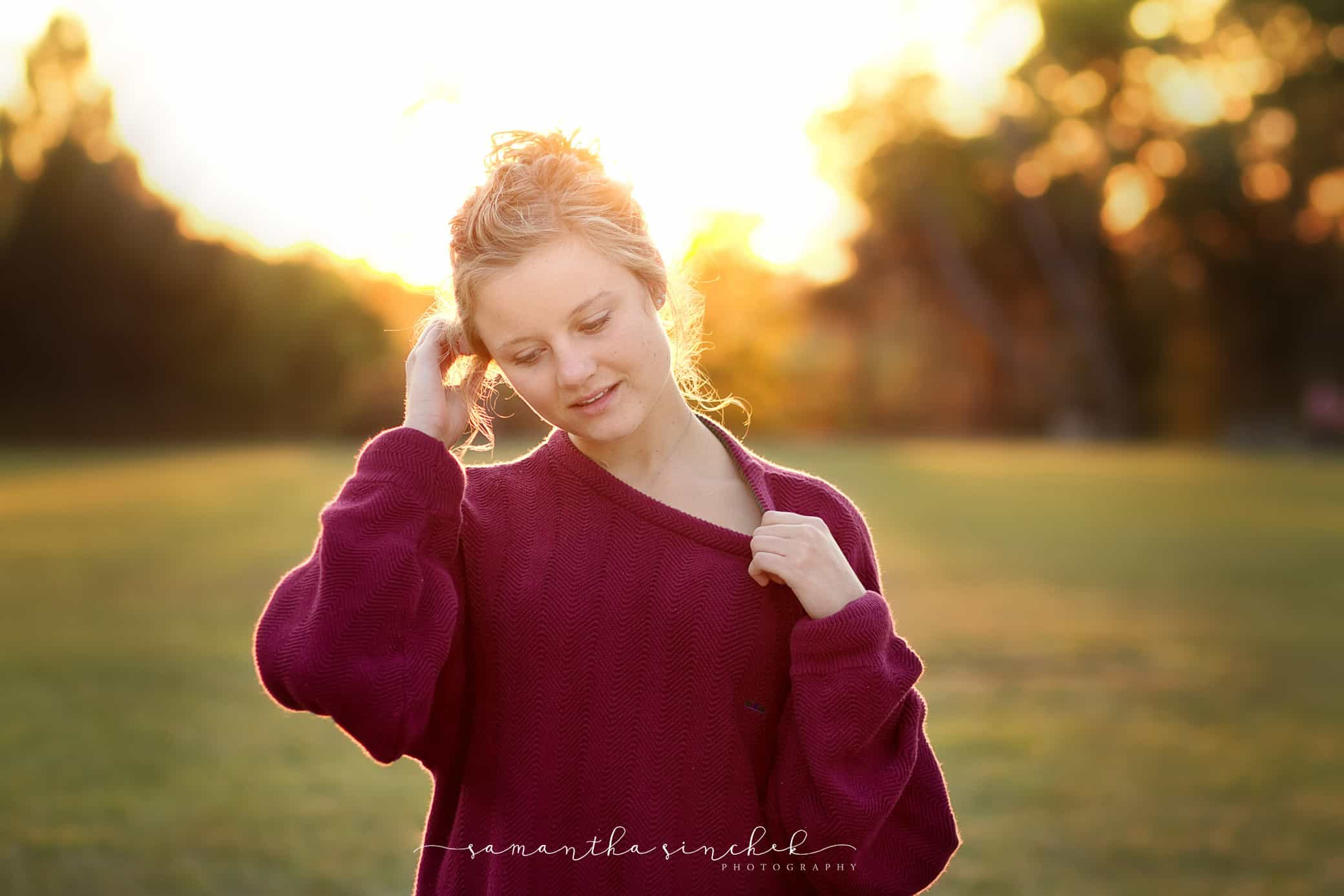 backlit photo at ault park of girl wearing sweater