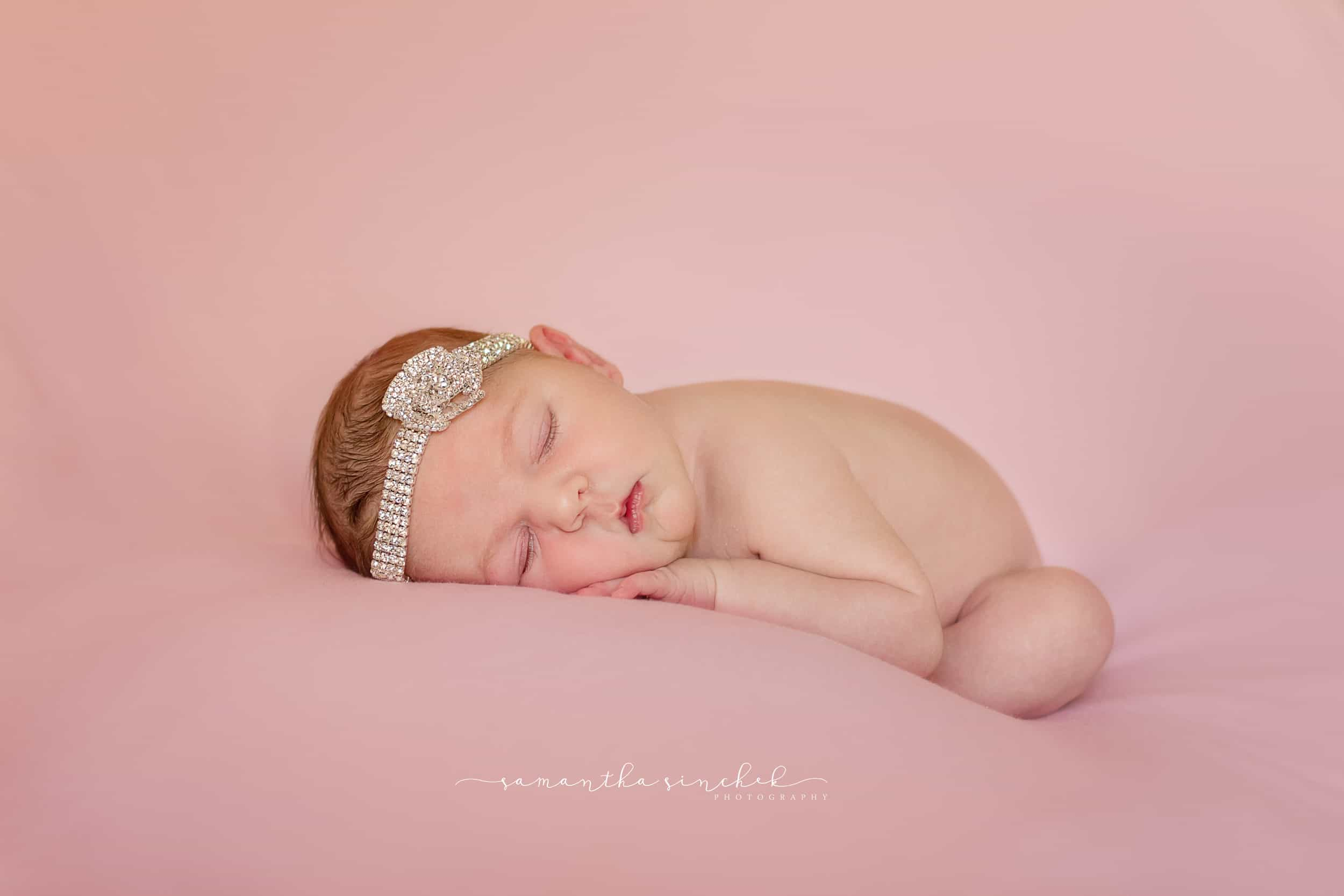 Cincinnati newborn sleeps wearing diamond headband