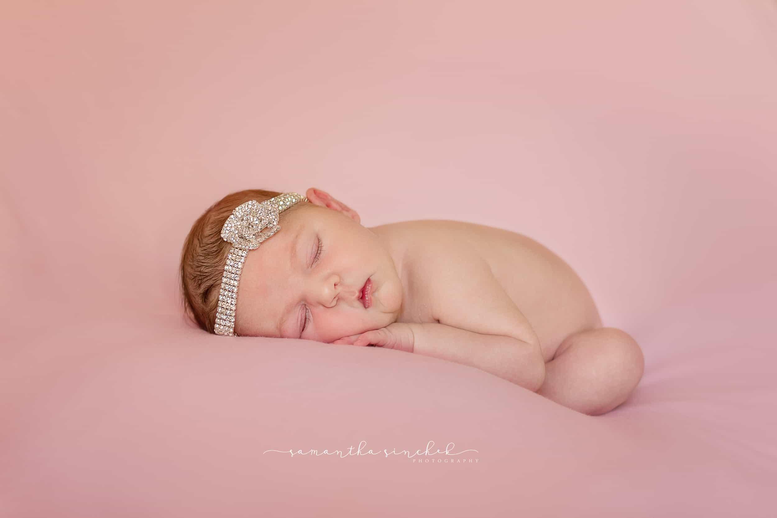 Cincinnati newborn sleeps wearing diamond headband