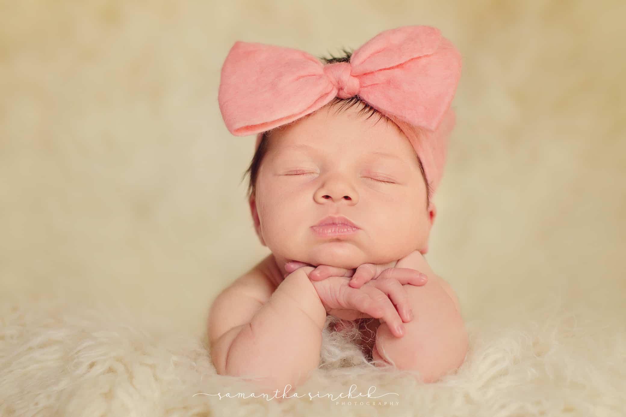 baby girl wears pink headband bow
