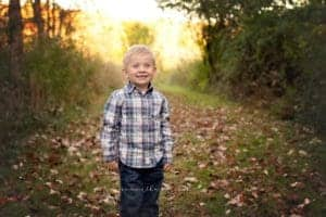 boy poses at cincinnati photographer mini session with samantha sinchek at french park