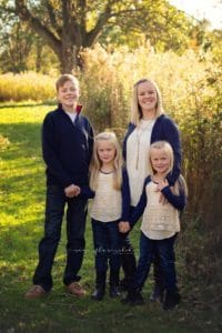 family poses for mini session with samantha sinchek photography at french park in the fall