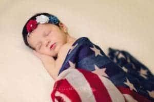 samantha sinchek photography photographs sleeping newborn wearing american flag scarf