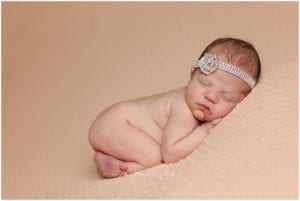 best cincinnati newborn photographer captures sleeping newborn at her reading home