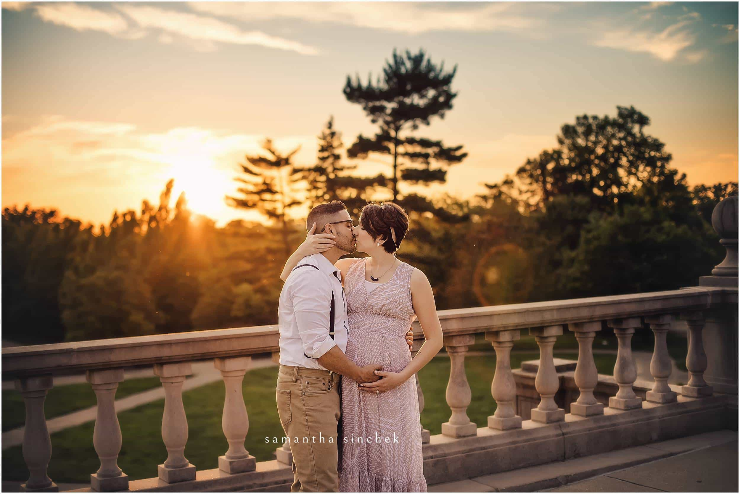 couple kisses on ault park balcony in cincinnati with samantha sinchek photography